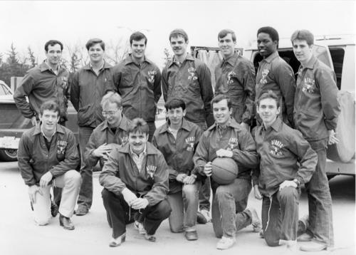 A black and white photo taken of the Air Force ROTC's men's basketball team at the University of Nebraska at Omaha., UNO Libraries' Archives & Special Collections