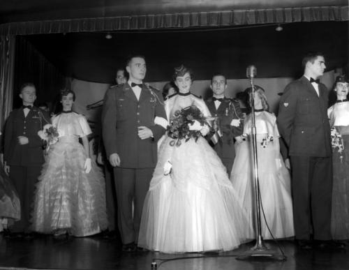A group of male and female members of the Air Force ROTC stand as Honorary Colonels at the University of Omaha's Military Ball of 1954., UNO Libraries' Archives & Special Collections
