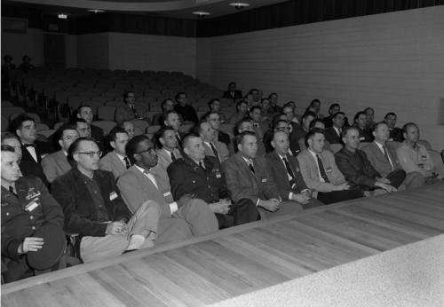 At the University of Omaha, bootstrappers congregate together in an auditorium at Milo Bail where they are addressed., UNO Libraries' Archives & Special Collections