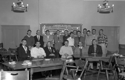Boostrappers assembled behind tables in a classroom., UNO Libraries' Archives & Special Collections