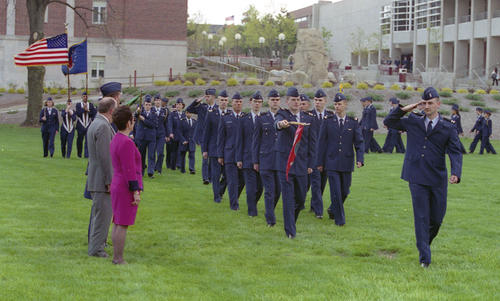 UNO Chancellor Nancy Belck Reviewing members of the Air Force ROTC on the Pep Bowl field at the University of Nebraska at Omaha., UNO Libraries' Archives & Special Collections