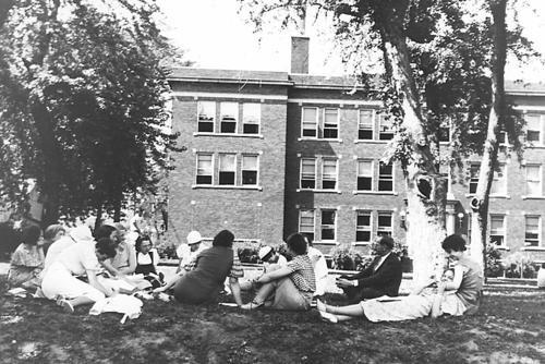 Students in a class seated outside of Joslyn Hall on the University of Omaha campus in North Omaha in 1933., UNO Libraries' Archives & Special Collections