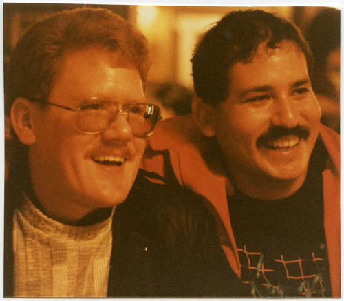 Tom Peterson (a Caucasian man on left) with friend (Latino person on right), both smiling., UNO Libraries' Archives & Special Collections