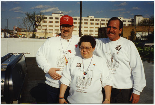 "Pat Phalen, Sandy Waldren and Dick Brown (Caucasian people) all wearing ""Nebraskans March On Washington"" sweatshirts designed by Terry Sweeney for the 1993 March on Washington for Lesbian, Gay, and Bi Equal Rights and Liberation., UNO Libraries' Archives & Special Collections"