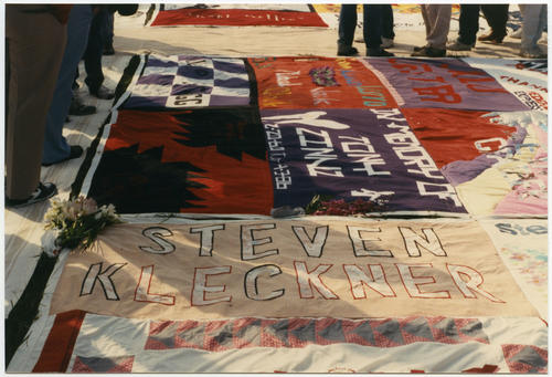 Close-up image of NAMES Project AIDS Memorial Quilt at the 1987 unveiling on the National Mall in Washington, D.C. showing a panel made in honor of Steve Kleckner [Each individual 3' by 6' quilt panel is the size of a human grave]., UNO Libraries' Archives & Special Collections