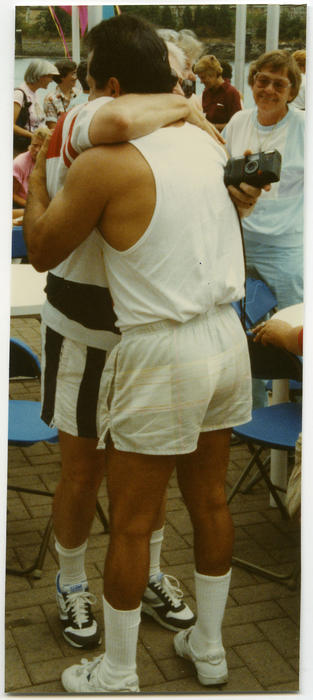 Two unidentified Caucasian people hugging at Gay Games III in Vancouver, British Columbia, Canada., UNO Libraries' Archives & Special Collections