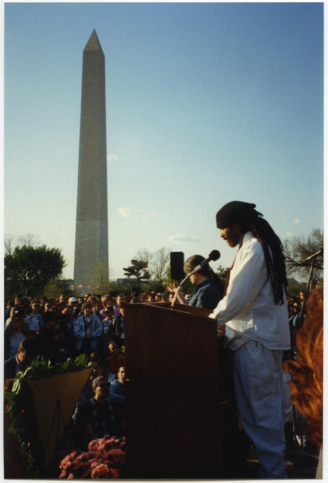 An unidentified person speaking with the Washington Monument visible in the background at the candle light vigil at the U.S. Holocaust Memorial Museum., UNO Libraries' Archives & Special Collections