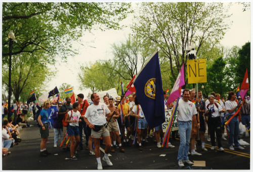 "Dick Brown with Nebraska's state flag, Rick Tornow with Pink ""N"" flag (both Caucasian adults) at the 1993 March on Washington for Lesbian, Gay, and Bi Equal Rights and Liberation., UNO Libraries' Archives & Special Collections"
