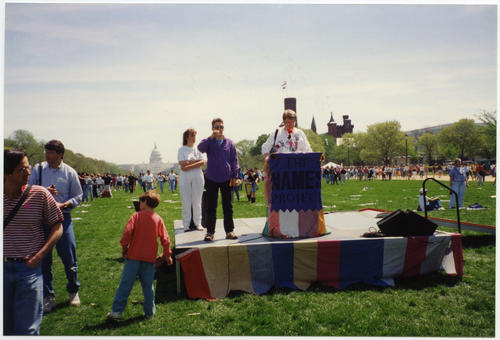 Terry Sweeney reading at The Names Project AIDS Memorial Quilt display in Washington, D.C. during the 1993 March on Washington for Lesbian, Gay, and Bi Equal Rights and Liberation., UNO Libraries' Archives & Special Collections