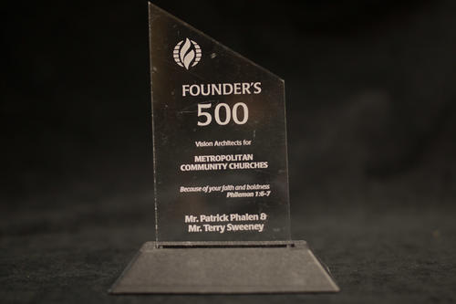 "Photograph of award given to Patrick Phalen and Terry Sweeney by Metropolitan Community Church of Omaha, Nebraska. The award is a clear plastic top with a black base., Award reads, ""Founder's 500 - Vision Architects for Metropolitan Community Churches - ""Because of your faith and boldness"" -Philemon 1:6-7 - Mr. Patrick Phalen & Mr. Terry Sweeney."", UNO Libraries' Archives & Special Collections"