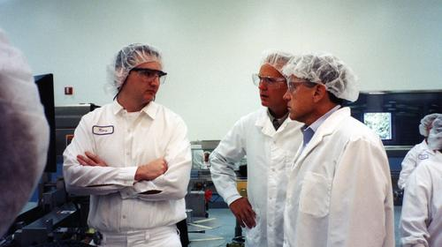 Senator Hagel, on right, at the Novartis Plant in Lincoln, Nebraska. The plant was purchased by GlaxoSmithKline in 2015., UNO Libraries' Archives & Special Collections