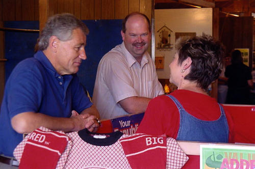 Senator Hagel visiting the GOP booth at the Box Butte County Fair at the Hemingford Fairgrounds, Hemingford, Nebraska., UNO Libraries' Archives & Special Collections