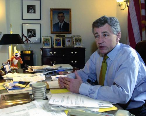 Hagel sits at his desk in his Senate office., UNO Libraries' Archives & Special Collections
