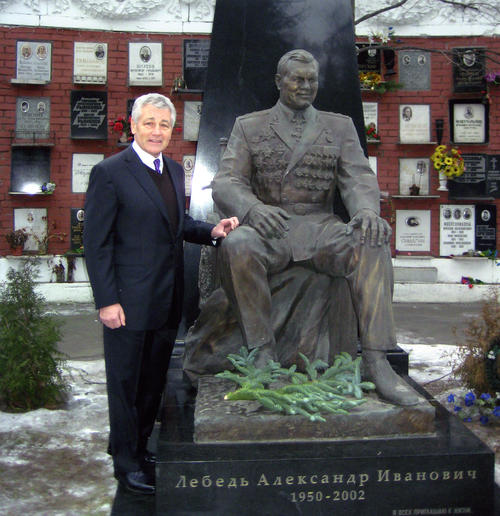 Photograph of Senator Hagel in Moscow, standing beside a statue., UNO Libraries' Archives & Special Collections